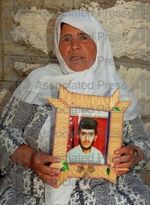 Fatma Harizat w/photo of son